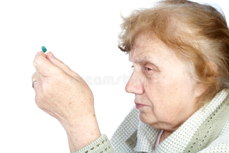 The old woman holds in hands capsule royalty free stock photos