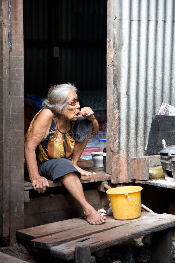 A old woman living in a slum royalty free stock photo