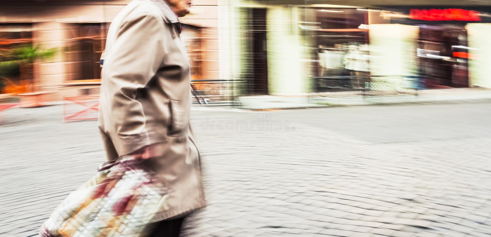 Old woman in motion blur royalty free stock images