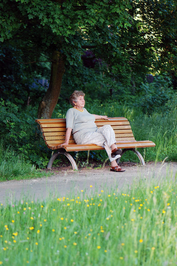 Free Old Woman On A Park Bench Thinking Royalty Free Stock Image - 14455576