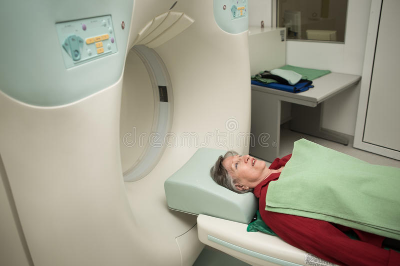 Old woman patient at computerized axial tomography (CAT) scan.Examining cancer patient with CT.Tumor detection. Modern medical equipment, preventional medicine royalty free stock image