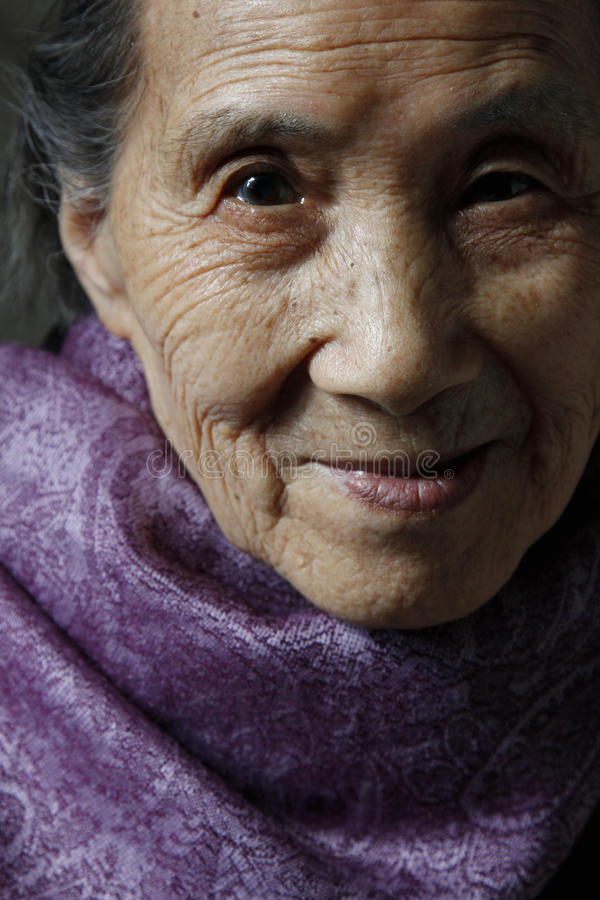 Old woman portrait close-up. The old woman was 90 years old, his face full of kindly smile. Photo taken in April 19, 2015. In Chongqing city Chinese royalty free stock photos