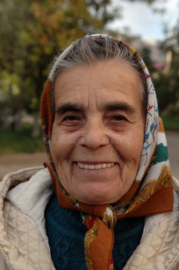 Old woman. Portrait. Wise. stock photo