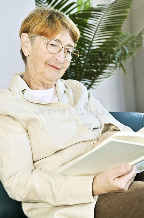 Download Old woman reading book stock photo. Image of literature - 8467234