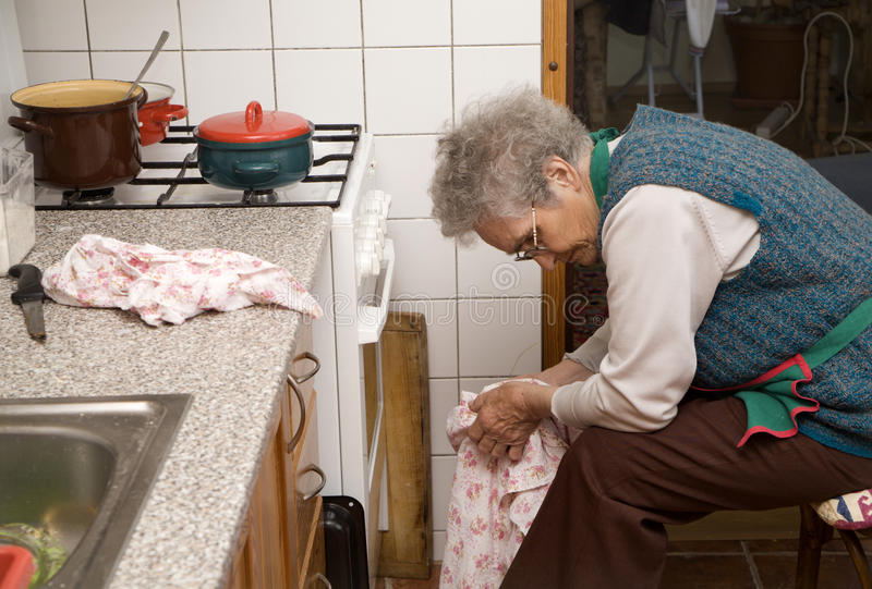 Download Old Woman By Rest In Kitchen Stock Photos - Image: 10650443