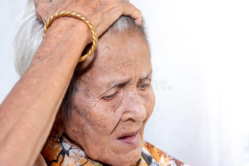The old woman`s felling lonely.dementia and Alzheimer's disease stock image
