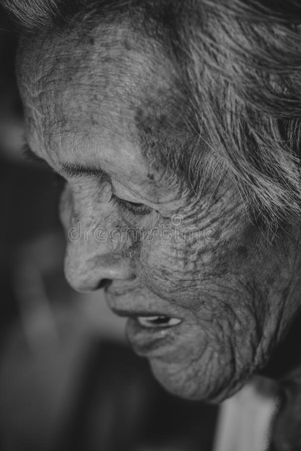 The old woman`s felling lonely. ,she`s senior woman in family and the elderly. stock photography