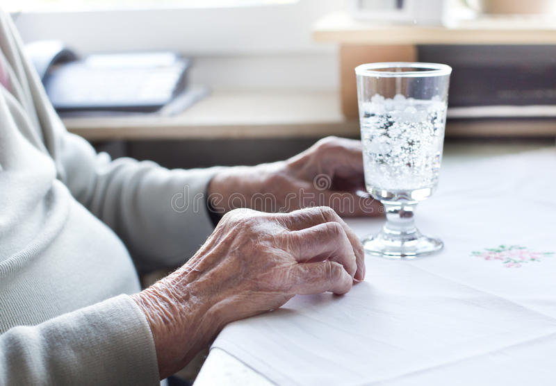 Old woman`s hands royalty free stock photos