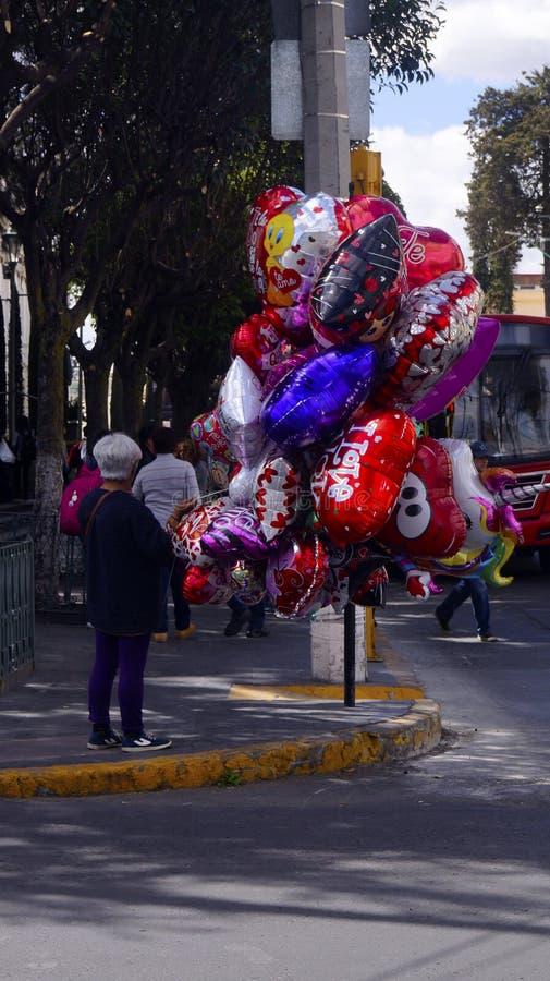 Female balloon seller stock image