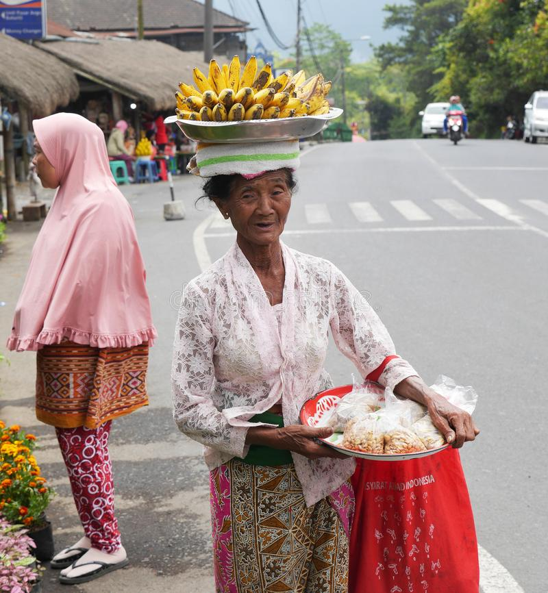 Old woman selling bananas at the farmers market stock photos