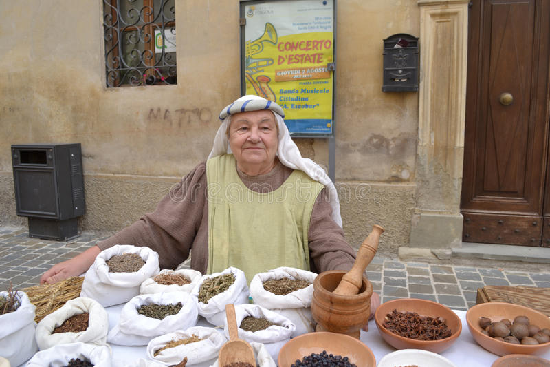 Old woman selling spices. At the market in Italy