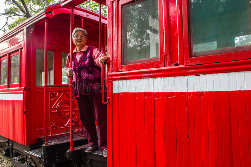 Old woman on a Sightseeing Train royalty free stock image