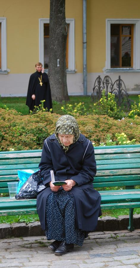 Download Old Woman Sitting On A Bench Reading A Book Editorial Stock Image - Image: 26624024