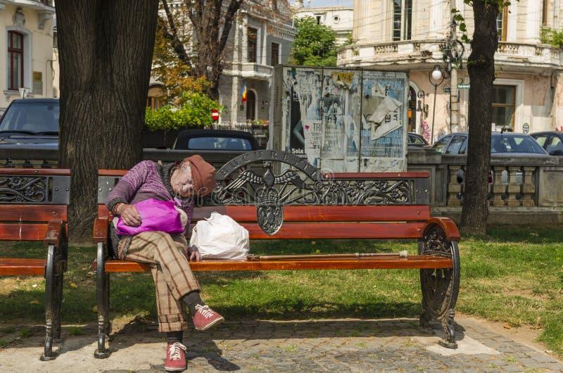 Old woman sleeping outside stock image