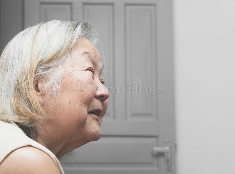 Old woman smiling aligned to the left. Grandma with white hair, brazilian, japanese descendant royalty free stock photos