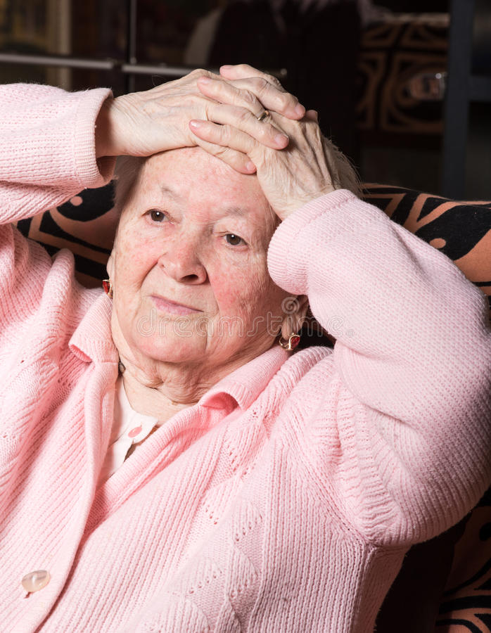 Old woman suffering from headache stock image