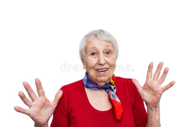 Old Woman with surprised expression on her face. Old smiling woman with surprised expression on her face on studio background. Human emotions concept. Positive royalty free stock photos