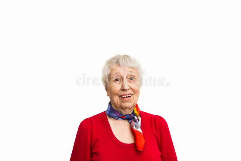 Old Woman with surprised expression on her face. Old smiling woman with surprised expression on her face on studio background. Human emotions concept. Positive royalty free stock image