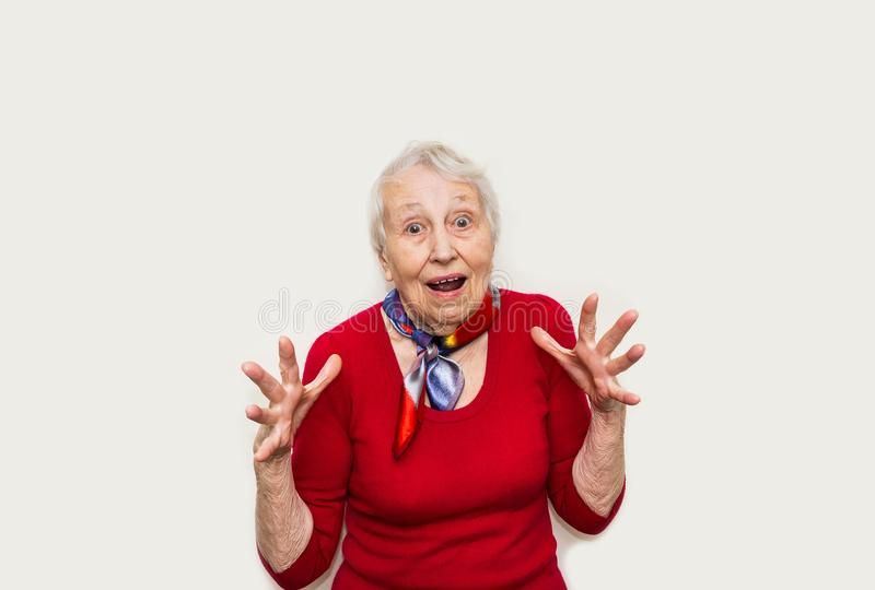 Old Woman with surprised expression on her face. Wow. Old Woman with surprised expression on her face on white studio background. Human emotions concept royalty free stock image