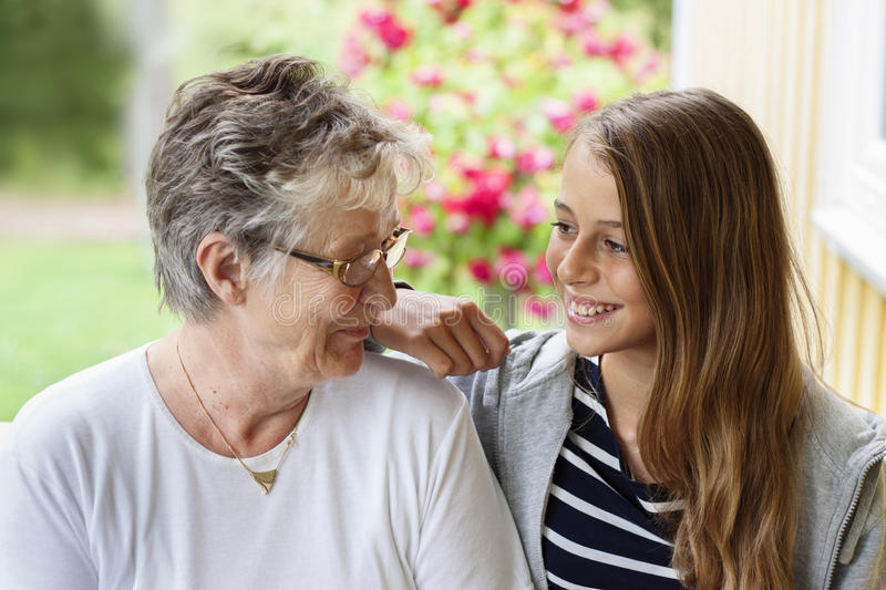 Old woman and teenager royalty free stock image