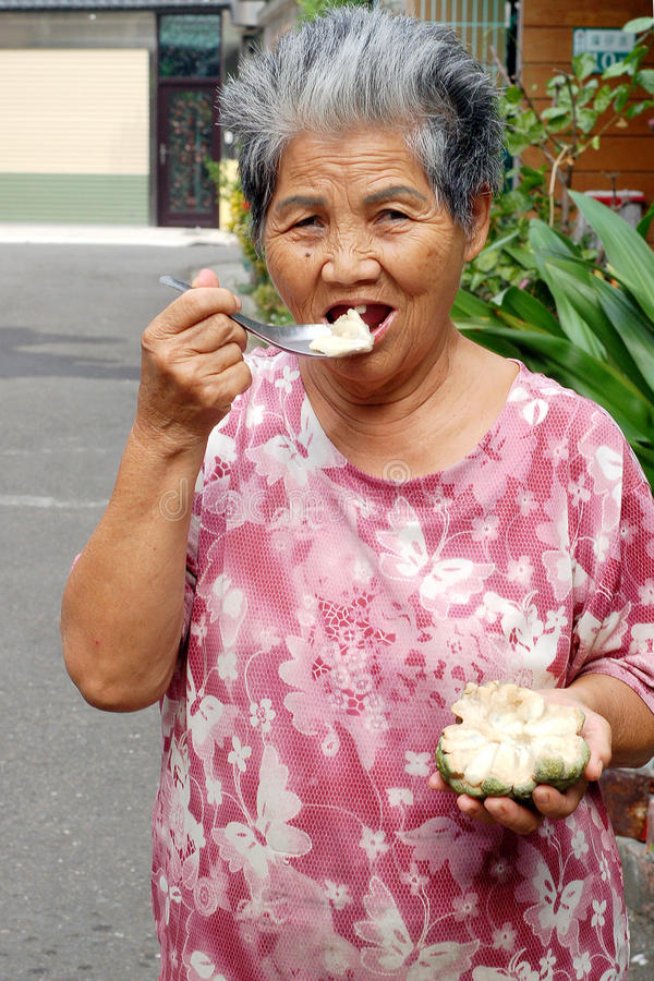 Old woman to eat the Taiwan Buddha royalty free stock photography