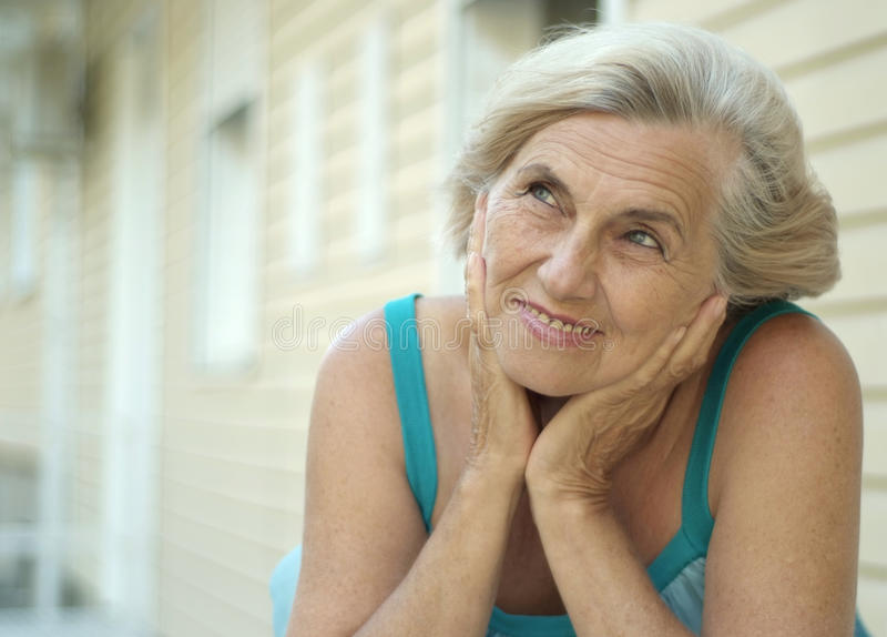 Old woman on walk stock photography