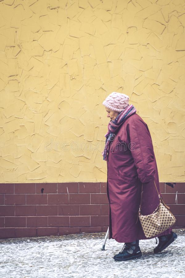 Old woman walking slowly royalty free stock photography
