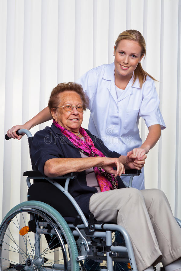 Download Old Woman In A Wheelchair And A Nurse Stock Image - Image: 21527595