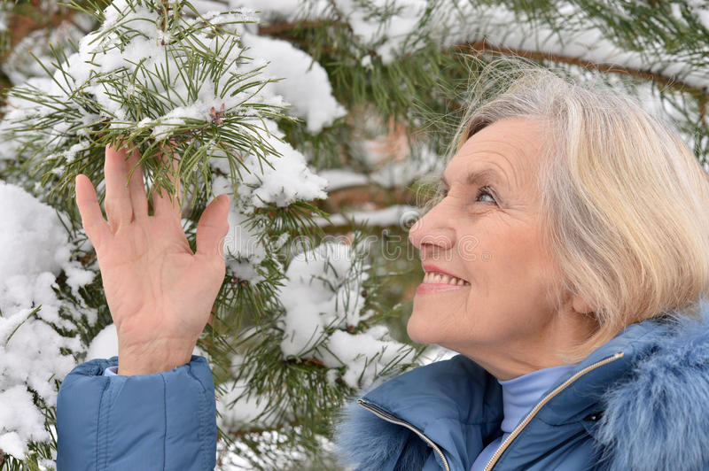 Old woman in the winter royalty free stock photo