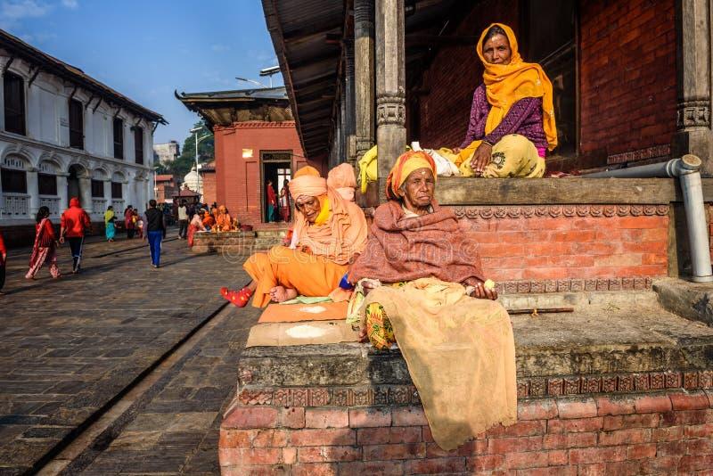 Old women begging at Pashupatinath Temple complex in Kathmandu,. KATHMANDU, NEPAL - OCTOBER 20, 2015 : Old women begging at Pashupatinath Temple complex in royalty free stock photo