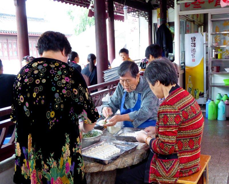 Old women making ravioli stock image