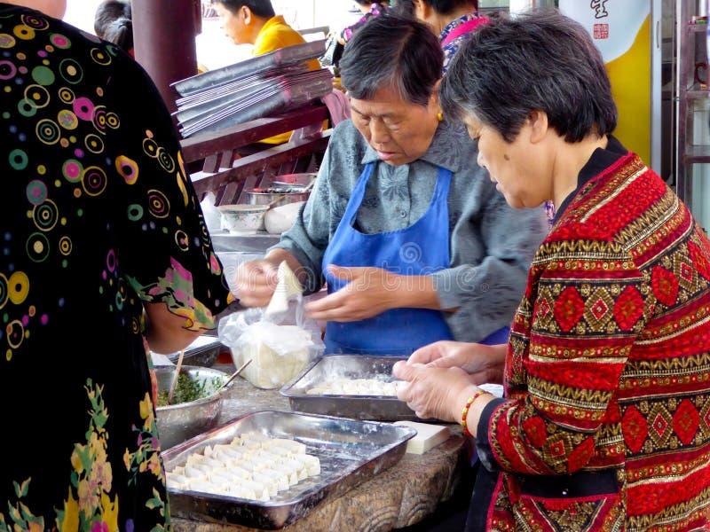 Old women making ravioli royalty free stock image