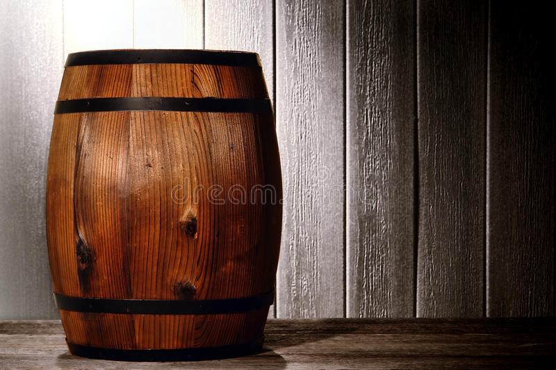 Old Wood Antique Whisky Barrel in Aged Warehouse stock photo