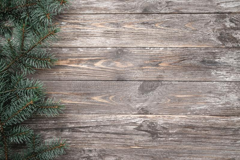 Old wood background with fir branches. Space for a greeting message. Christmas card. Top view royalty free stock images