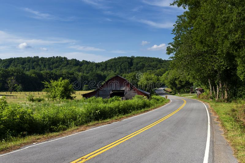 An old wood barn along a country road in rural Tennessee, stock photography