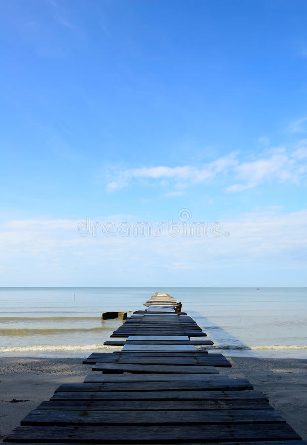 Old wood bridge on the beach. In Thailand stock image