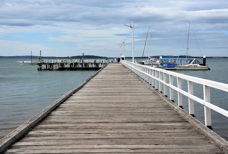 Old wood bridge pier at Rhyll. Rhyll, Australia - December 29, 2016. Old wood bridge pier at Rhyll Philip Island, Victoria, Australia. Old wooden jetty with royalty free stock photography