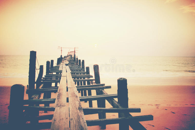 Old wood bridge to the sea stock photography