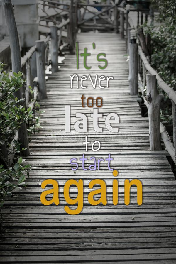 """Old Wood bridge with word """"It's never too late to start again.  royalty free stock photo"""