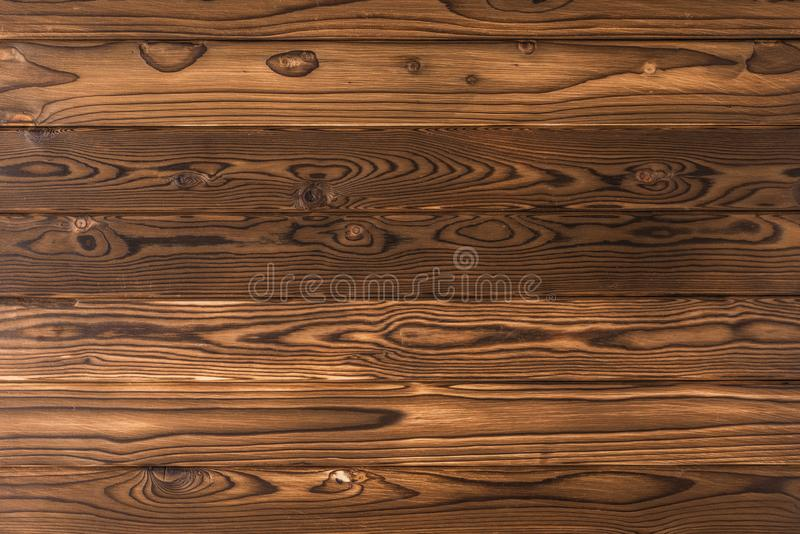 Old wood brown burned planks of pine tree. texture and background. stock image