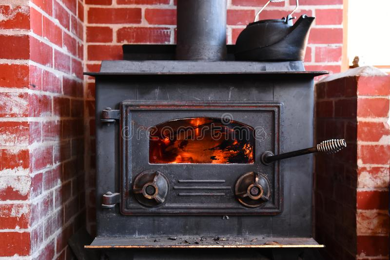 Old Wood Burning Stove. An image of an old wood burning stove with cast iron antique kettle stock photo