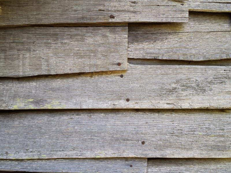 Old wood clapboard siding on abandoned house. Wood clapboard siding on abandoned house royalty free stock image