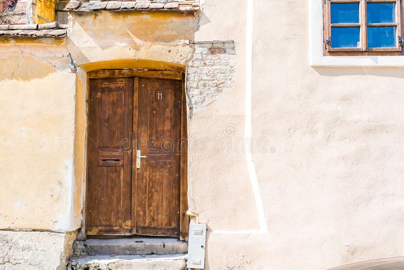 Old wood door on colorful medieval streets of Sighisoara. Romania royalty free stock image