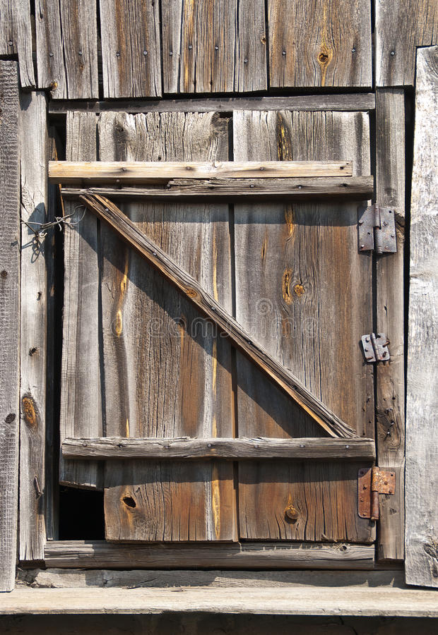Old wood door on garret. Old wood hinged door on garret stock photo