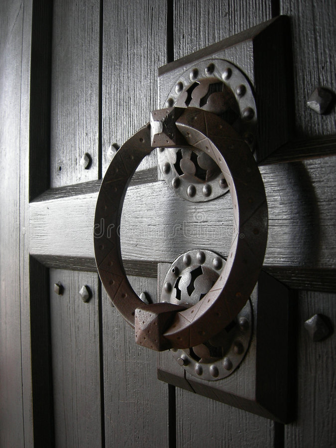 Old wood door with handle royalty free stock photography