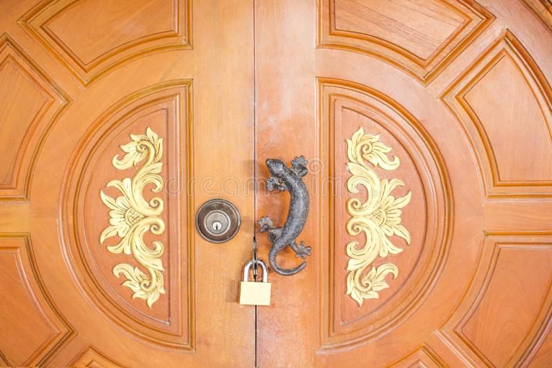 Old  wood door with lock and black gecko handle on background royalty free stock image