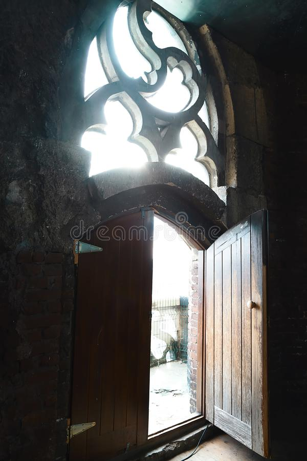 Free Old Wood Door With A Small Handle On Red Brick Wall Background, Vintage Window, Rays Of Light, Open Door With Two Parts Royalty Free Stock Photography - 109425277