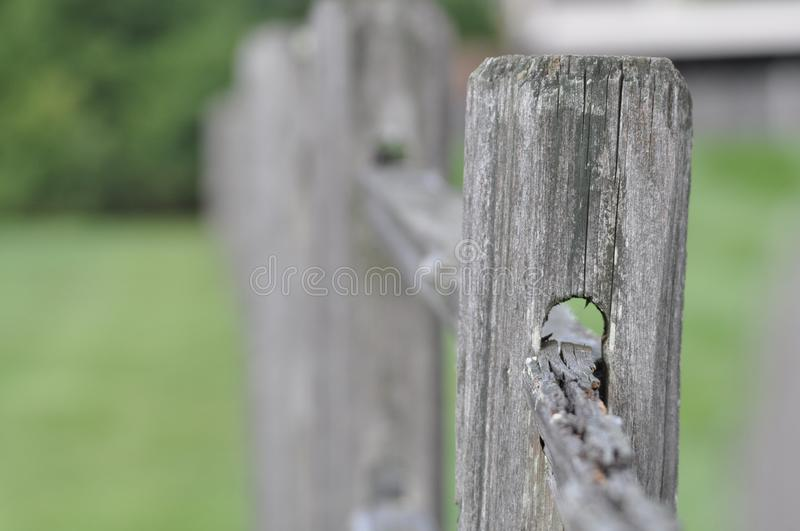 Closeup of a wood fence in a park. A weathered wood fence in a park royalty free stock photos
