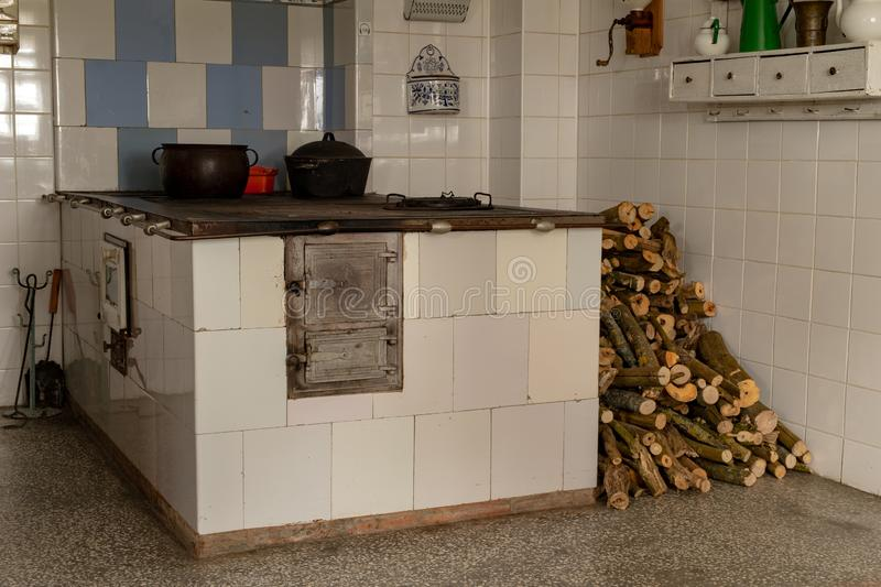 An old wood-fired kitchen in a country house. A place to prepare meals in an old house royalty free stock photography