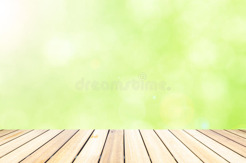Old wood floor in front of abstract color bokeh background royalty free stock photos
